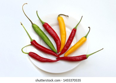 Fresh organic spicy hot paprika vegetables and spices in white plate