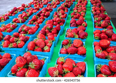 Fresh organic strawberries at a local farmers market.