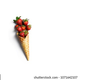 Fresh organic strawberries in waffle ice cream cone with copy space. Healthy eating concept.