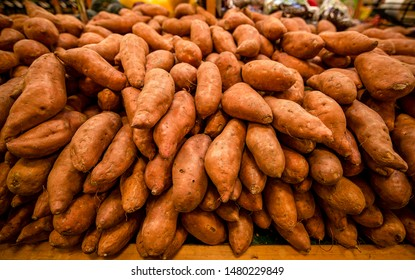Fresh organic sweet potatoes in market