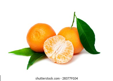 Fresh organic tangerine fruits with green leaves isolated on white background