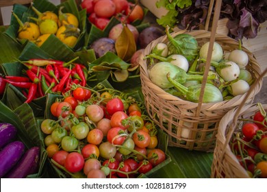 Fresh organic vegetables in baskets made of handmade bamboo.