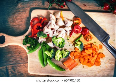 Fresh organic vegetables in cooking setting. Healthy eating and diet concept