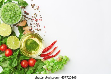 Fresh organic vegetables, fruit, herbs and spices selection on white background. Background layout with free text space. Close up,  top view.