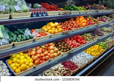 Fresh organic Vegetables and fruits on shelf in supermarket, farmers market. Healthy food concept. Vitamins and minerals.