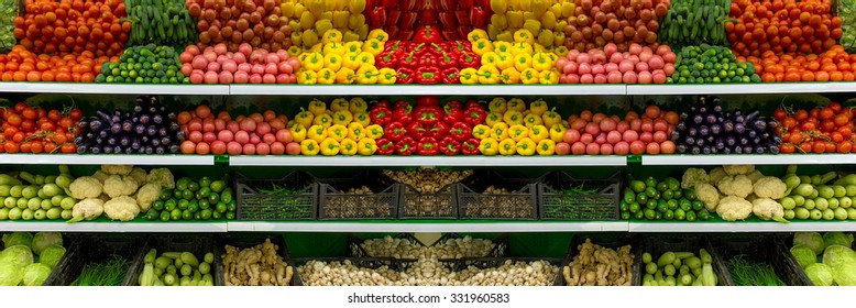 Fresh organic Vegetables and fruits on shelf in supermarket, farmers market. Healthy food concept. Vitamins and minerals. Tomatoes, capsicum, cucumbers, mushrooms, zucchini,  Vegetables, Vegetables...
