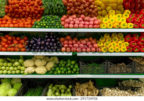 Fresh organic Vegetables and fruits on shelf in supermarket, farmers market. Healthy food concept. Vitamins and minerals. Tomatoes, capsicum, cucumbers, mushrooms, zucchini...