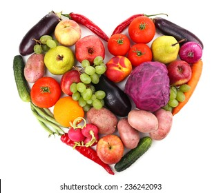 Fresh organic vegetables and fruits in shape of heart, isolated on white