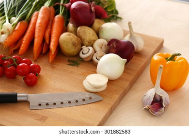 Fresh organic vegetables on a table with a knife for cooking