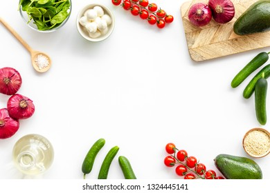 Fresh organic vegetables on white background top view space for text. Kitchen desk for preparing salad frame