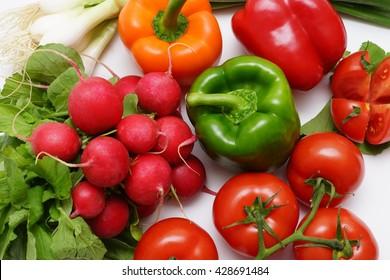 Fresh organic vegetables on a white background