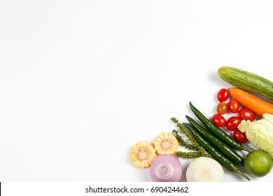 Fresh organic vegetables on white background .