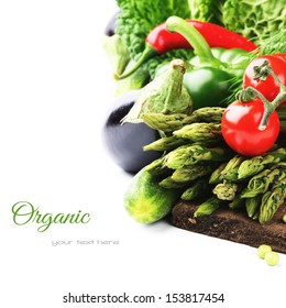 Fresh organic vegetables on wooden cutting board