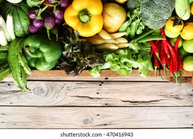 fresh organic vegetables on wooden floor with copy space.