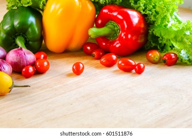 fresh organic vegetables on wooden floor with copy space. concept vegetables fresh from the farm.