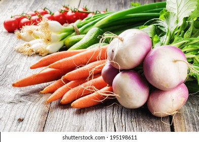 Fresh organic vegetables in rustic setting