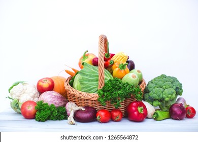 Fresh organic vegetables in wicker basket isolated. Vegetable background.