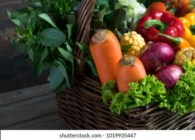 fresh organic vegetables in wood basket on wooden floor with copy space. concept vegetables fresh from the farm.Vegetable garden organic.