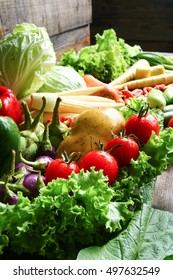 fresh organic vegetables in wood crates on wooden floor with copy space. concept vegetables fresh from the farm.