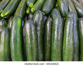 Fresh organic zucchini at a local farmers market.