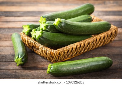 Fresh organic zucchini on the wooden table