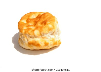 A  Fresh from the Oven Piping Hot Golden Brown Flour Biscuit isolated on white with room for your text. Flour Biscuits are eaten around the world by hungry people, with Fried Chicken, Gravy and more.