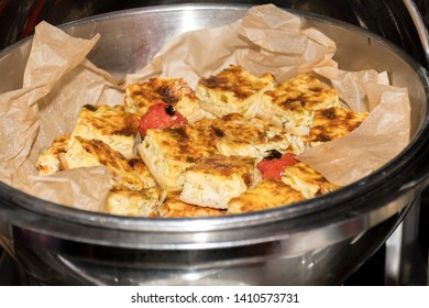 Fresh from the oven quiche Lorraine tart during brunch buffet in hotel, catering or private business event self service table, individual dish and food display in hot station table variety display