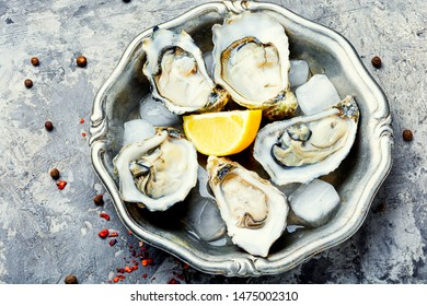 Fresh oyster in dish with lemon and lemon