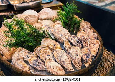 Fresh oyster on ice as street food at Nishiki market in Kyoto, Japan