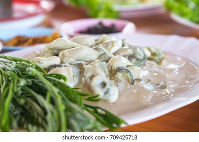Fresh Oyster with side dishes and spicy seafood sauce