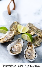 fresh oysters and lime on a marble board