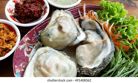 Fresh oysters with Thai-style  condiments