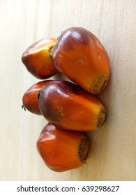 Fresh palm fruit on wooden background. low light, selective focus, blur image