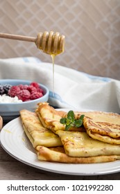 fresh pancakes with fragrant maple syrup and honey. Russian holiday pancake week. crepes with honey or syrup.