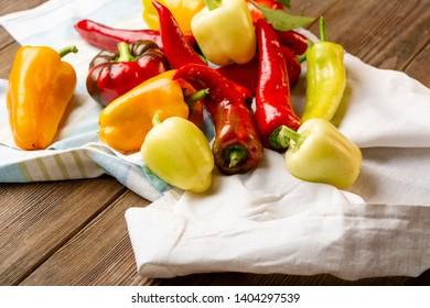 Fresh paprika on wooden board