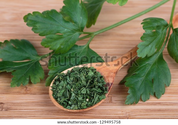 fresh parsley and dry on a wooden background