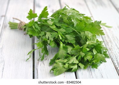 Fresh parsley on an old white table