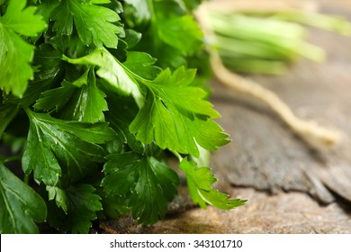 Fresh parsley on wooden background
