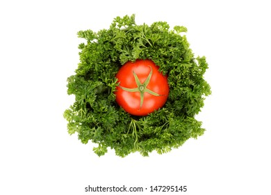 Fresh parsley and tomato in bowl isolated on white background.