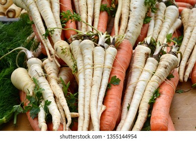 Fresh, parsnips and carrots at the weekly market. A bunch of carrot and parsnip. Full frame of vegetable.