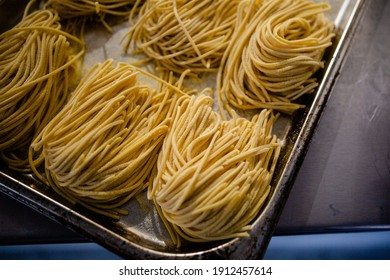 Fresh pasta being rolled and sliced