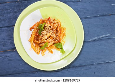 Fresh pasta over wooden board. Above view horizontal shot