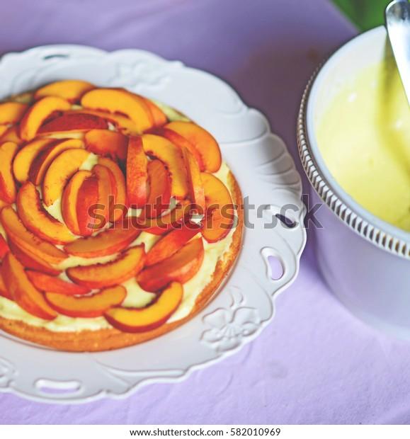 Fresh peach cake on table