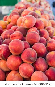 Fresh peaches at the farmers market display