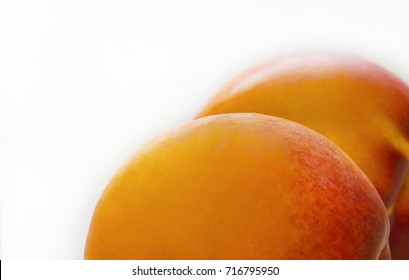Fresh peaches isolated on white. Peaches in form of asshole. Image for advertising medicine service anti cellulite.