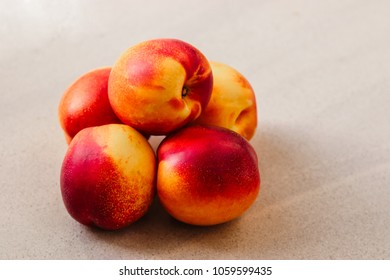 a lot of fresh peaches. peaches on a marble background. Flat lay, top view. as a background. vegan food