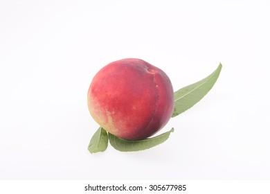 Fresh peaches in a white background