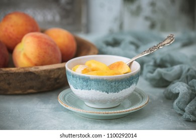 Fresh Peaches in a Wooden Bowl; Peaches and Cream in Bowl; Soft Green Backgroung