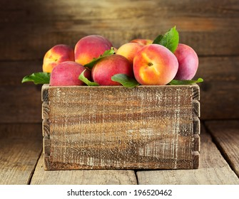 fresh peaches in wooden box