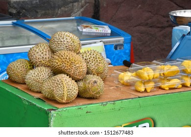 Fresh and pealed Durian fruits closeup view. The durian is the fruit of several tree species belonging to the genus Durio